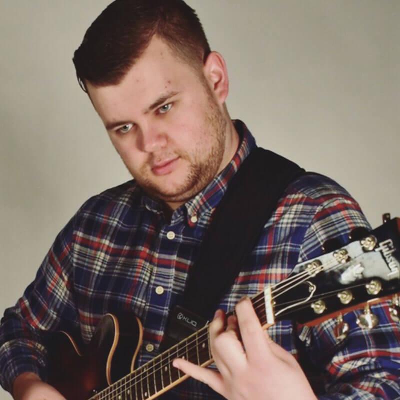 Avery Scanlon playing the guitar